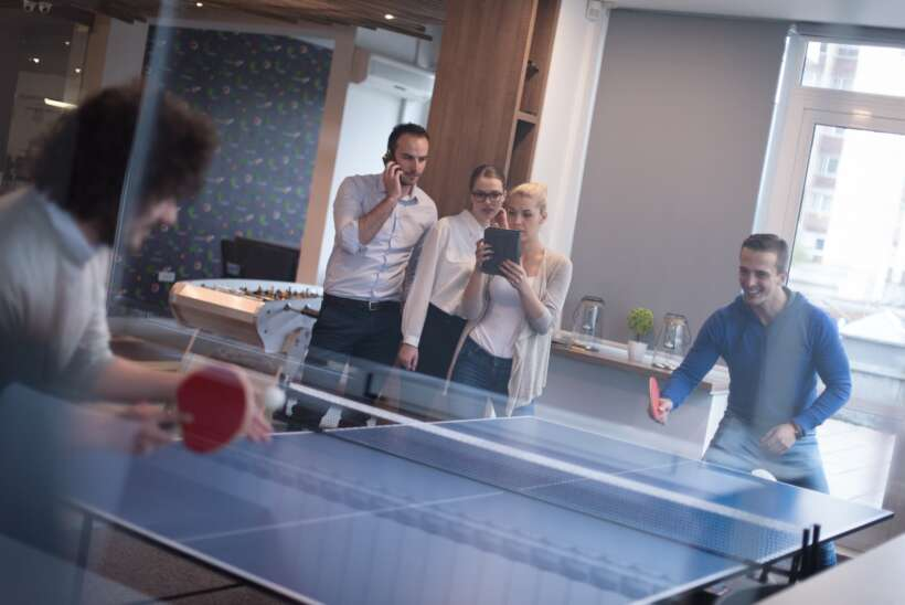 P11 ctouch business team playing ping pong tennis min 1